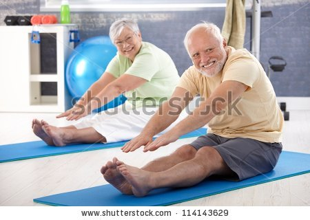 stock-photo-elderly-couple-stretching-in-the-gym-114143629